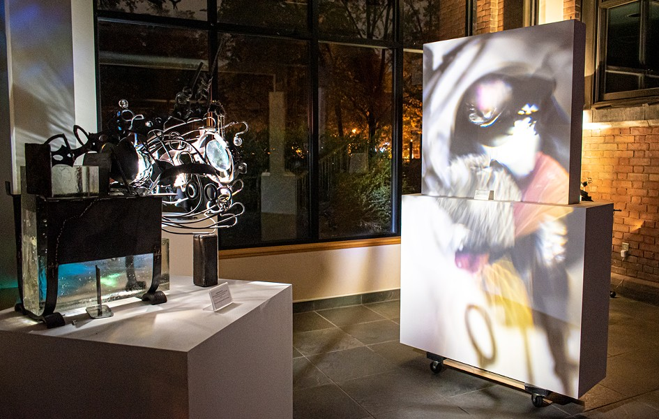 """Annalisa Barron's """"Place Projectors"""" in the atrium of Writers & Books. - PHOTOS BY JACOB WALSH"""