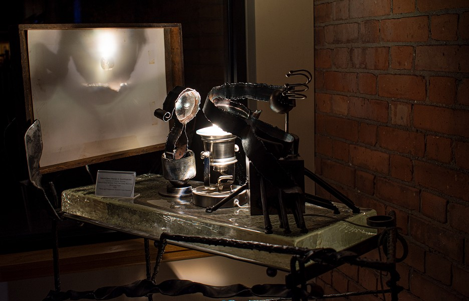 """Annalisa Barron's """"Place Projectors"""" in the atrium of Writers & Books. - PHOTO BY JACOB WALSH"""