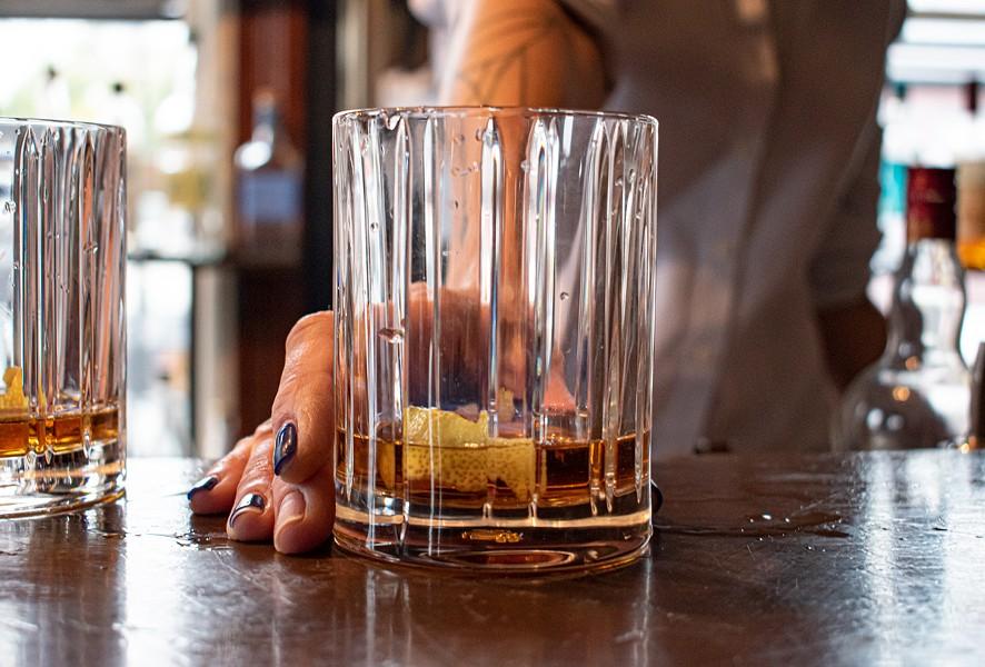 "Cheshire's bourbon-based ""Blue Blazer."" - PHOTO BY JACOB WALSH"