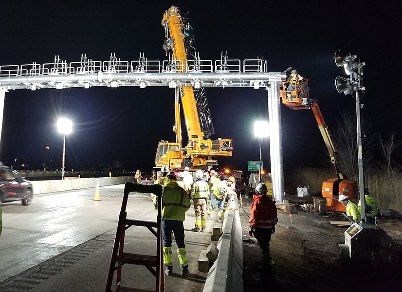 A crew installs a gantry over Thruway lanes in the Syracuse suburb of Manlius. - PHOTO PROVIDED BY NYS THRUWAY AUTHORITY