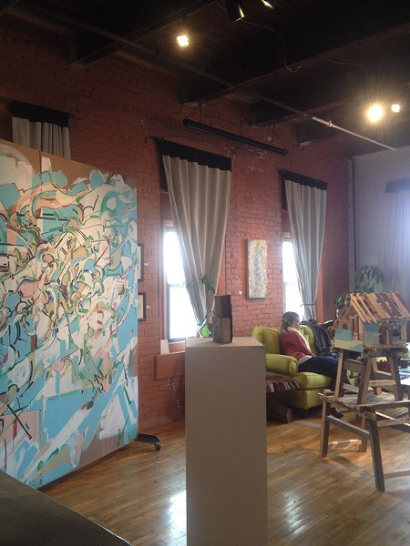 With its cozy features and cheerful vibe, visiting Makers feels like hanging out in a friend's apartment. At right: one of Nate Hodge's large paintings was recently displayed at the gallery. - PHOTO BY REBECCA RAFFERTY