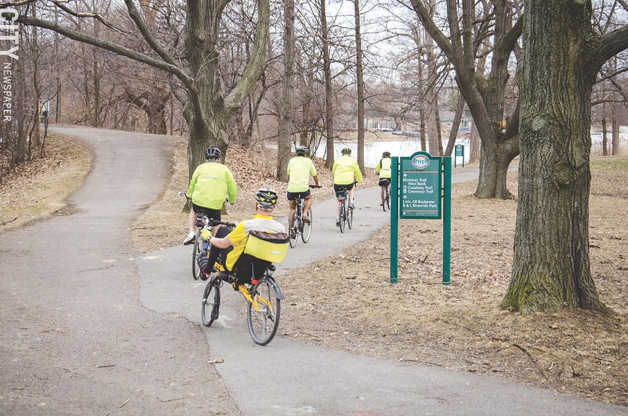 A biking group rides through Genesee Valley Park. - PHOTO BY MARK CHAMBERLIN