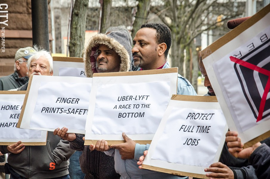 Local cab drivers rallied against Uber at City Hall last month. - PHOTO BY MARK CHAMBERLIN