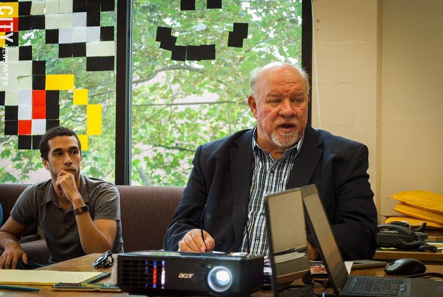 John Klofas (right), director of the Center for Public Safety Initiatives at RIT, and research assistant and graduate student Aaron Baxter. - PHOTO BY RYAN WILLIAMSON