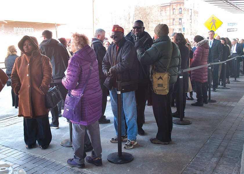 People began to line up outside of Eastman Theatre around 9 a.m. to attend the 11 a.m. funeral service for Louise Slaughter. - PHOTO BY RENÉE HEININGER
