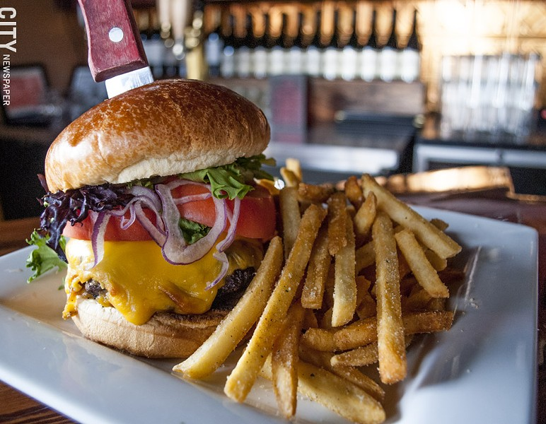 The Tavern at Gibbs's Tavern Burger on a brioche bun with Yukon gold potato fries. - PHOTO BY RENÉE HEININGER