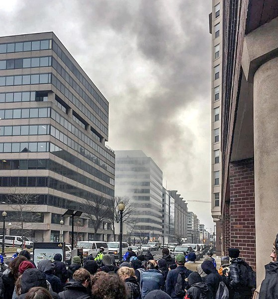 Smoke from a burning limousine as seen hours after mass arrests on Inauguration Day. - PHOTO BY AARON CANTÚ