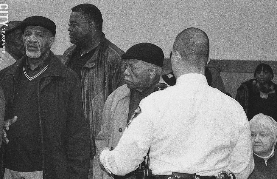 Florence (second from right) and Raymond Scott (left) were arrested during a 2008 protest at the County Office Building. The issue: the County Legislature's politicization of the public defender selection process. - PHOTO BY JEREMY MOULE