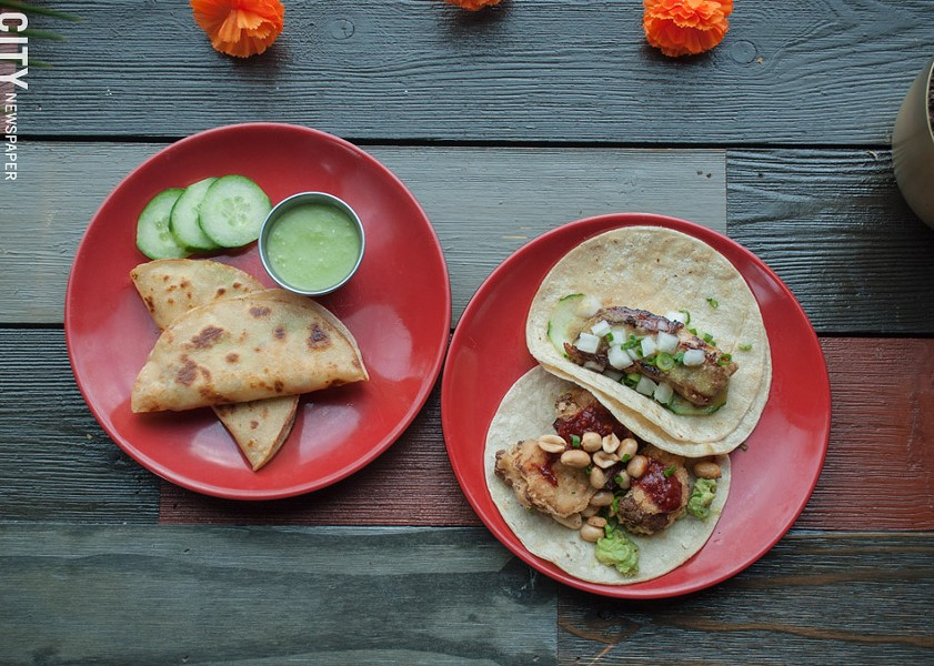 On the menu at Lulu Taqueria, from left: Smoked swordfish tacos are served with a side of salsa verde. The pork belly taco (top right) and cauliflower taco featuring avocado, peanuts, honey roja salsa (bottom right). - PHOTO BY REBECCA RAFFERTY