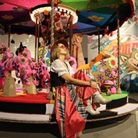 Olek Olek with crochet-wrapped merry-go-round. PHOTO COURTESY OLEK