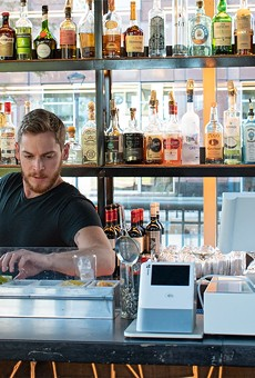 Adam tends the bar at VOLO.
