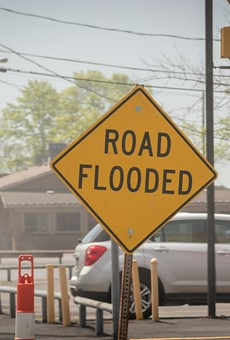 A road sign warns of flooding on Edgemere Drive in Greece.