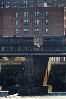 As CSX locomotive passes over High Falls in the city of Rochester. Tankers full of crude oil and liquid propane already pass through Monroe County on a regular basis and trains hauling liquefied natural gas could soon join them.