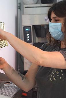 Katarina Schwarz of Katboocha pours a cup of pine needle kombucha.