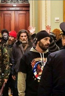 Federal prosecutors say the bearded man in the center of the photo is Dominic Pezzola of Rochester.