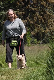 Ingrid Bock walks Diesel on a Penfield trail.