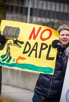Protesters gathered in front of the Federal Building on Friday to demonstrate against President Donald Trump's executive orders on the Keystone XL and Dakota Access pipelines.