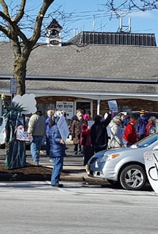 Demonstrators have gathered outside of House Representative Chris Collins's Geneseo office every Tuesday for the past few weeks in an attempt to get him to hold a town hall meeting.