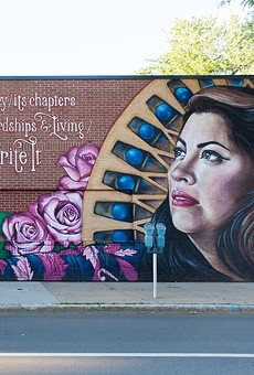 """Detail of a mural featuring Rachel McKibbens, part of Sarah Rutherford's """"Her Voice Carries"""" project."""
