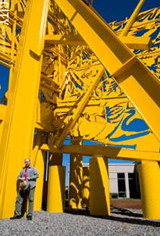 "Albert Paley in 2007, with his large-scale sculpture ""Threshold,"" at Klein Steel in Rochester."