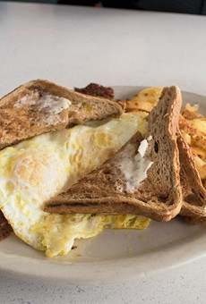 Served 24/7 at Jay's Diner: Corned beef hash with two eggs over easy, home fries, and wheat toast.