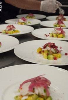 The second course of the Dia de los Muertos dinner at Atlas Eats is ceviche with lime scallops atop a bed of chopped avocado, mango, and slices of fresh coconut.
