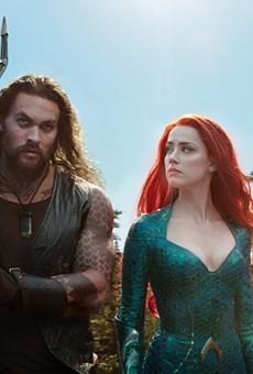 "Jason Momoa and Amber Heard in ""Aquaman."""