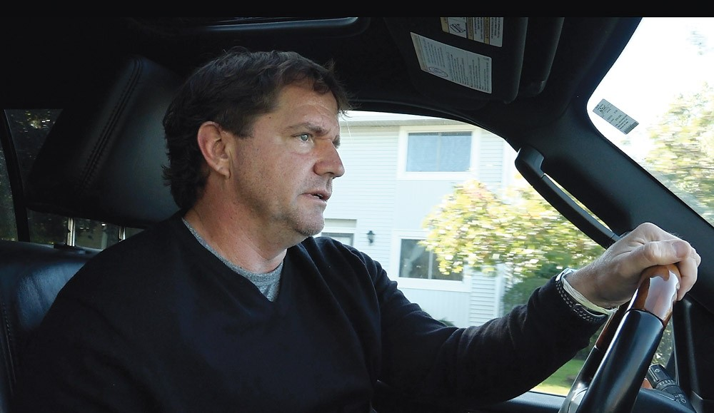 Rick Bates driving around his old neighborhood in his Lincoln Navigator. He says of his lawsuit that he wants vindication and to help other victims speak out. - PHOTO BY MAX SCHULTE