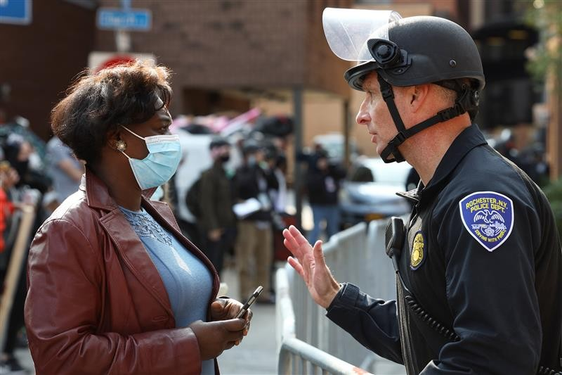 the Rev. Myra Brown of Spiritus Christi Church talks with Rochester Police Capt. Ray Dearcop - PHOTO BY MAX SCHULTE