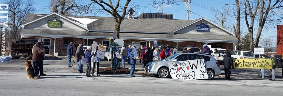 Demonstrators have gathered outside of House Representative Chris Collins's Geneseo office every Tuesday for the past few weeks in an attempt to get him to hold a town hall meeting. - PHOTO BY JEREMY MOULE