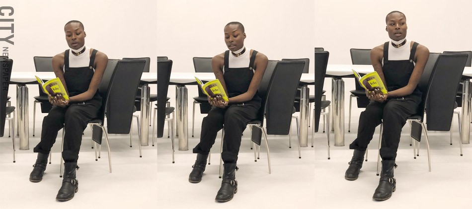 """Jahmal B. Golden reads from their book of poetry, """"Yves, Ide, Solstice."""" - PHOTOS BY REBECCA RAFFERTY"""