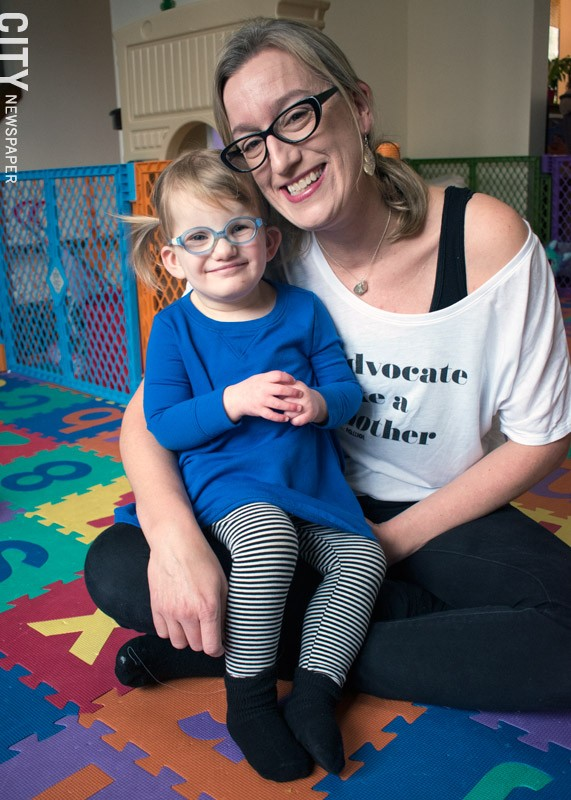 Kim Dooher says that the Early Intervention providers who have worked with her daughter, Vivian, are responsible for much of the 2 ½-year-old's progress and development. - PHOTO BY RENÉE HEININGER