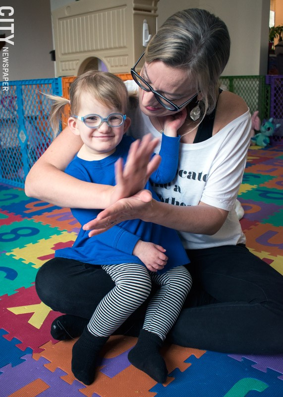 Vivian Dooher doesn't communicate verbally, so she and her mother talk using ASL. - PHOTO BY RENÉE HEININGER