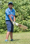 Third-grader  Arjun Savudu plays both cricket  and baseball.