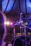 """A contortionist performs in """"Cabinet of Wonders"""" inside of the Spiegeltent during the 2015 Rochester Fringe Festival."""