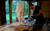 "Aaron Delehanty, founder of 2 Loud Cows, finishing a sculpture of a ""Winged Genie"" Assyrian figure, created for for the Islamic Food Council of America."