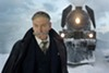 "Kenneth Branagh and train in ""Murder on the Orient Express."""