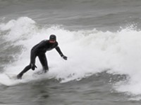 Surfer takes on Great Lakes and winter storms