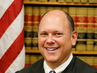Former Monroe County judge accused of sexual abuse by secretary