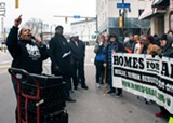 PHOTO BY RENÉE HEININGER - Advocates for quality, affordable housing protested last week in front of the Hotel Cadillac in downtown Rochester.