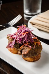PHOTO BY MARK CHAMBERLIN - The Cub Room uses a seasonal menu with a focus on fresh ingredients, locally sourced when possible. Seen here are the house smoked pork cheeks with ginger slaw.