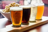 PHOTO BY MARK CHAMBERLIN - A beer flight and spiced popcorn with honey and brown butter.