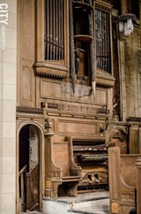 PHOTO BY MARK CHAMBERLIN - The organ inside the 1912 chapel in Mount Hope Cemetery has deteriorated beyond use. The chapel has been out of use for decades
