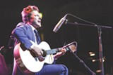 """PHOTO COURTESY GEVA THEATRE CENTER - Singer-songwriter Benjamin Scheuer wrote and performs in - the one-man show """"The Lion,"""" currently on stage at Geva - Theatre Center's Fielding Nextstage."""