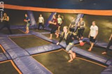 PHOTO BY MARK CHAMBERLIN - Teams square off at Sky Zone during a game of trampoline dodgeball.