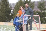 PHOTO BY MIKE HANLON - Craig Abbott and his family in their Victor backyard. Growing up, Abbott skated on the edges of a shallow creek. This season he's building a 32-foot by 44-foot rink.