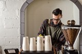 PHOTO BY MARK CHAMBERLIN - Ugly Duck Coffee owner Rory Van Grol slings espresso at Fiorella during a pop-up coffee bar last week.