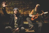 """PHOTO BY RON HEERKENS JR. - Kyle Hatley as The Poet and - Raymond Castrey as The Musician in """"An Iliad,"""" on - stage now at Geva Theatre Center."""