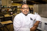 PHOTO BY MARK CHAMBERLIN - East High School senior Dominique Brown has participated in his school's culinary program since he was a freshman, and is now working with the Rochester Youth Culinary Experience. The organization aims to open a restaurant in Village Gate this summer.