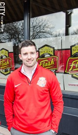 PHOTO BY MARK CHAMBERLIN - Flash general manager Rich Randall outside the team's new HQ on University Ave.
